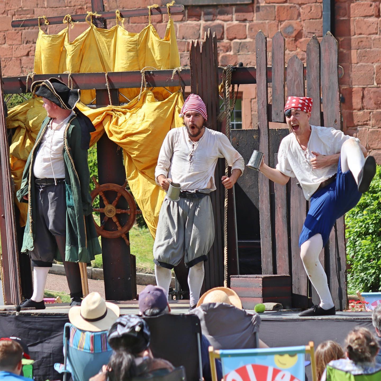3 actors dressed as pirates